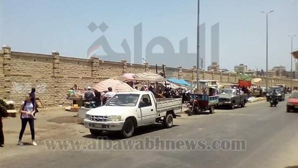 : بالصور.. تنظيم الباعة الجائلين بمحيط مدافن بورسعيد