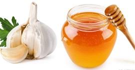 تعرف على أبرز فوائد العسل بالثوم