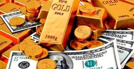 الذهب يصعد مع تراجع الدولار الأمريكى عن ذروة شهر